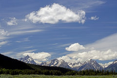 Beautiful blue skies and snow covered mountains in Yellowstone. Yellowstone National Park mountains and skies stock image