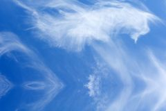 Beautiful blue sky. White clouds with reflection in water Royalty Free Stock Image