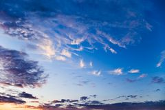 Beautiful blue sky. With clouds drifting at sunset royalty free stock photography