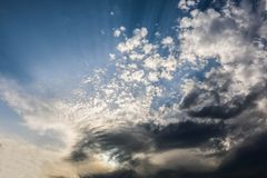 Beautiful Blue Sky Background With Dramatic Fluffy White Clouds And Sun Beam. Over Dubai, United Arab Emirates stock image