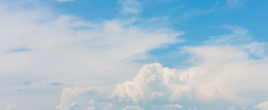 Beautiful blue sky background with white clouds on sunny day.  royalty free stock photos