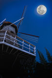 Beautiful blue sky and bright full moon with brown windmill. Out Royalty Free Stock Photography