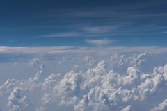 Beautiful blue sky and cloud view from an airplane window. background Royalty Free Stock Photo