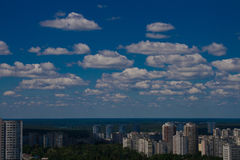 Beautiful blue sky with clouds above the city. Kiev, Ukraine Royalty Free Stock Photo