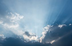 Beautiful blue sky and clouds. Sun rays royalty free stock photo