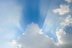 Beautiful blue sky and clouds. Sun rays. Ray of sunshine between the evening clouds Royalty Free Stock Photos