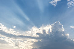 Beautiful blue sky with clouds and sunbeams sun rays Royalty Free Stock Photo
