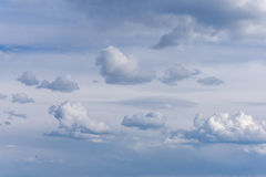 Beautiful blue sky with clouds at sunset, Cloudy sky background. Stock Images