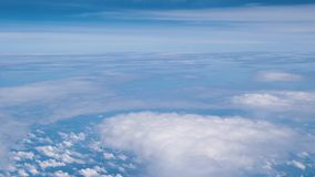 Beautiful blue sky and clouds from the windows of airplane.  stock footage