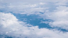 Beautiful blue sky and clouds from the windows of airplane.  stock video footage