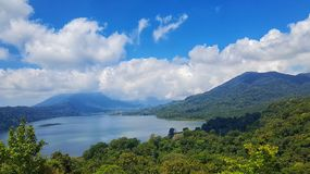 Beautiful Blue Sky with Cloudy and Green Landscape Mountain and lake royalty free stock photos