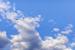 Beautiful blue sky covered in heights with white clouds. Beautiful blue sky covered in heights with white cumulus clouds stock photos