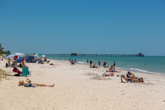 Beautiful blue sky day in the beach of Naples in Florida Royalty Free Stock Photography