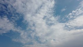 Beautiful blue sky filled with stratiform cirrus clouds floating in the air.  stock video footage
