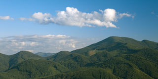 Beautiful blue sky and green forest mountain hills Royalty Free Stock Photography