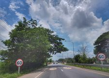 On The road from Nongkhai to Khonkaen, Thailand. Beautiful blue sky and green scenery along the side of the road from Nongkhai, Udon and Khonkaen, Thailand Royalty Free Stock Photography