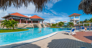 Beautiful blue sky holiday in Cuba.  View from pool,  getaway vacation in Varadero. Lay back on deck chairs.  Families and people relaxing on holidays Stock Photos