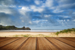 Beautiful blue sky morning landscape over sandy Three Cliffs Bay Royalty Free Stock Photography
