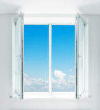 Beautiful blue sky seen through window Royalty Free Stock Images