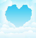 Beautiful blue sky with some romantic heart shaped clouds Royalty Free Stock Images