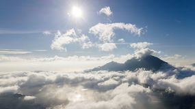 Beautiful blue sky with sun above Kintamani mountain Royalty Free Stock Images