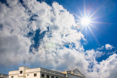 Beautiful blue sky with sun and clouds. Royalty Free Stock Photo