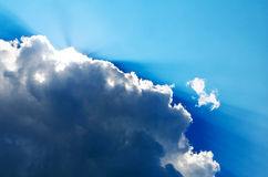 Beautiful blue sky. With sun rays playing with the clouds Stock Images