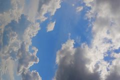 Beautiful  blue sky. With sun rays and white  clouds stock photo