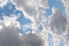 Beautiful  blue sky. With sun rays and white  clouds stock photography