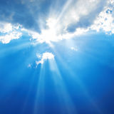 Beautiful blue sky. With sunbeams and clouds. Sun rays royalty free stock photo