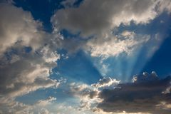 Beautiful blue sky with sunlight and cloud on evening.  stock images