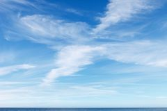 Beautiful blue sky with white Cirrus clouds. Background image stock photos