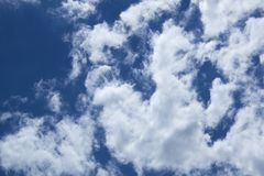 Beautiful blue sky with white clouds background. stock photography