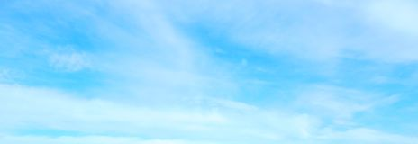 Beautiful blue sky with white fluffy clouds background royalty free stock photography