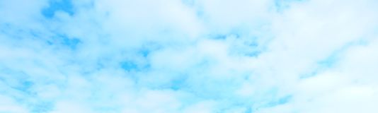 Beautiful blue sky with white fluffy clouds background stock images