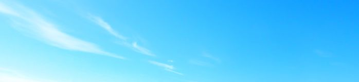 Beautiful blue sky with white fluffy clouds background stock photography