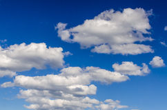 Beautiful blue sky with white fluffy clouds. Beautiful peaceful blue sky with white fluffy wispy clouds on it. Great photo as backgound for advertising copy and Royalty Free Stock Photo