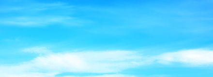 Beautiful blue sky with white fluffy clouds in summer morning peace day as a background royalty free stock photo