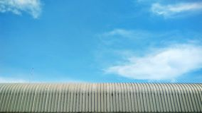 Beautiful blue sky. Zinc roof with blue sky background Stock Image