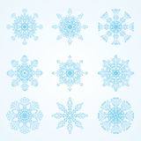 Beautiful blue snowflakes on light background. Vector set - beautiful blue snowflakes on light background. Use for snow/winter/Christmas texture. Use for Stock Image
