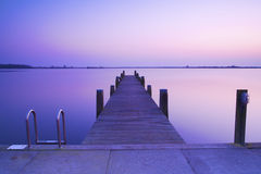 A beautiful blue sunset with a jetty Stock Images