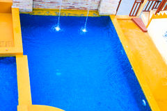 Beautiful blue swimming pool. Happy and relaxing in beautiful blue swimming pool Stock Photography