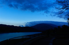 Beautiful blue twilight on the lake in the mountains. Royalty Free Stock Photography