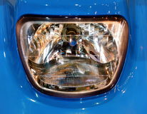 Beautiful blue vintage car close-up of headlight. Close-up of headlight. Projector of a  luxury car technology. Concept: auto detail,car care, car element Royalty Free Stock Image