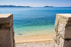 Beautiful blue water, beach in Croatia. Beautiful blue water on a sunny day, beach in Croatia Royalty Free Stock Image