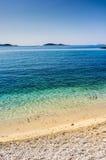 Beautiful blue water, beach in Croatia. Beautiful blue water on a sunny day, beach in Croatia Royalty Free Stock Images