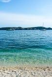 Beautiful blue water, beach in Croatia. Beautiful blue water on a sunny day, beach in Croatia Royalty Free Stock Photo
