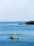 Beautiful blue water, beach in Croatia. Beautiful blue water on a sunny day, beach in Croatia Royalty Free Stock Photography