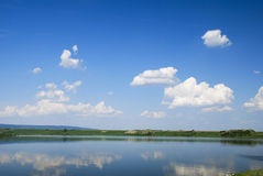 Beautiful blue water lake with sky reflection Stock Images