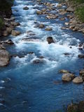 Beautiful blue water in the river in the green valle Royalty Free Stock Photography